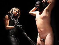 Mistress Dahlia notices some marks on her slave that she didn't give him.  She strings her slave up to a post in the dark and beats a confession out of him.  Mistress Dahlia uses paddles, crops, her h...
