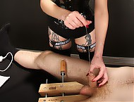 Mistress Nyxon gives her slave a wild ride. She puts his balls in a wooden carpenter vise to start off with. Nyxon then starts playing with metal sounds down his cock and fucks his hole. She keeps put...