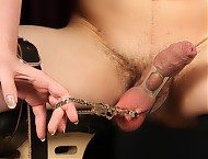 Kiki has her slave strapped down, legs spread, hands cuffed behind his back, and left with no way to defend himself.  Kiki uses a series of sharp pin wheels, clamps, paddles, and a cock cage on his co...